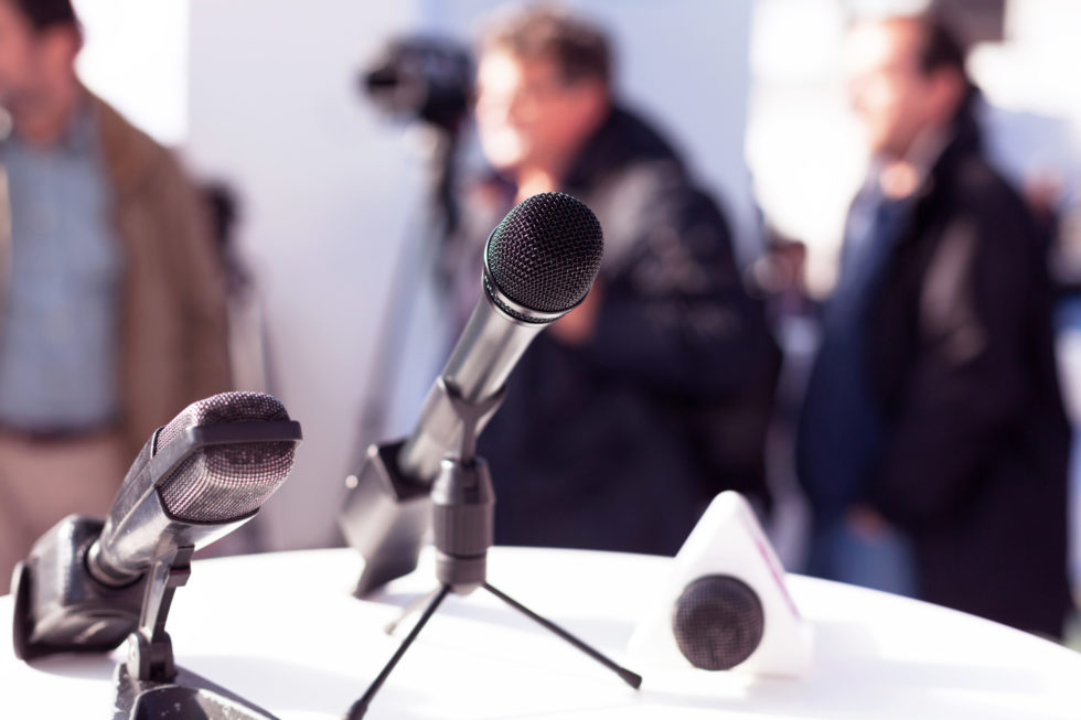 news conference with microphones
